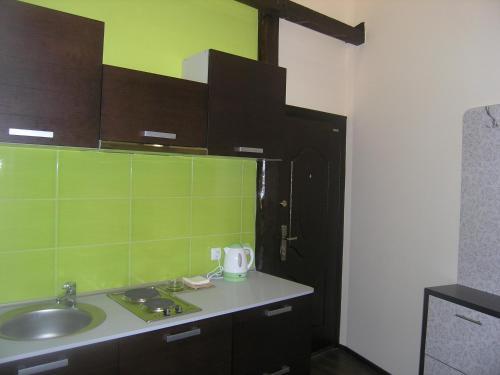A kitchen or kitchenette at Art Villa on Sumskaya Street