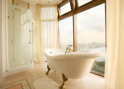 A bathroom at Triumph Palace Boutique Hotel