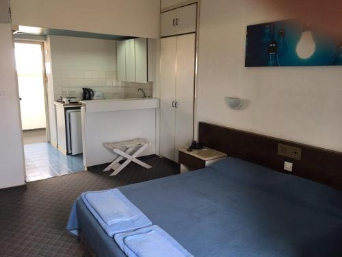 A bed or beds in a room at Sunflower Hotel Apartments