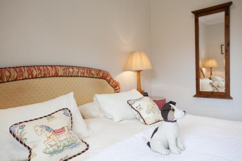 A bed or beds in a room at Kilcamb Lodge Hotel