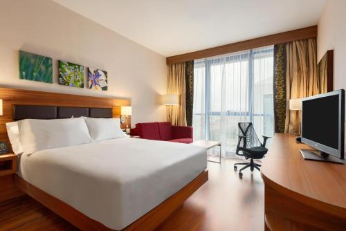 A bed or beds in a room at Hilton Garden Inn Sevilla