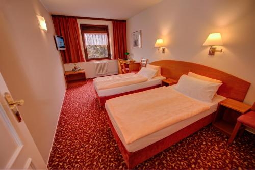 A bed or beds in a room at Park Hotel Pruhonice