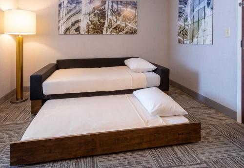 A bed or beds in a room at SpringHill Suites Rochester Mayo Clinic Area / Saint Marys