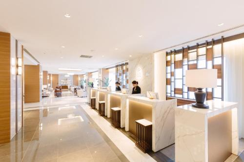 The lobby or reception area at JR Kyushu Station Hotel Kokura
