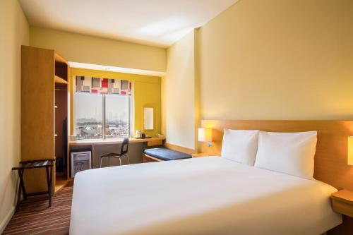 A bed or beds in a room at Ibis Deira City Centre