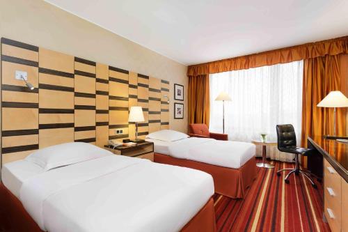 מיטה או מיטות בחדר ב-AZIMUT Hotel Olympic Moscow