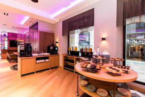 A restaurant or other place to eat at NYX Hotel Bilbao by Leonardo Hotels