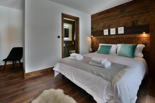 Postel nebo postele na pokoji v ubytování Les Trois Sieges