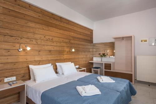 Ένα ή περισσότερα κρεβάτια σε δωμάτιο στο Esplanade Apartments