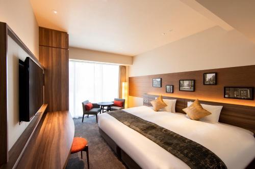 A bed or beds in a room at karaksa hotel premier Tokyo Ginza