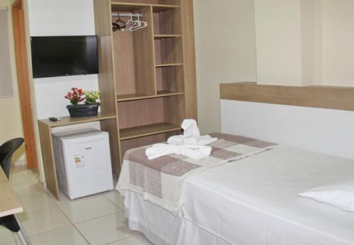 A bed or beds in a room at Hotel Recanto da Serra