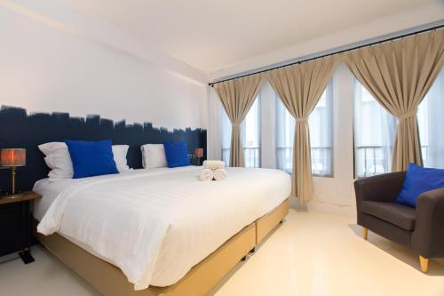 A bed or beds in a room at Xinlor House - SHA Plus