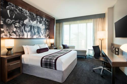 A bed or beds in a room at Texas A&M Hotel and Conference Center