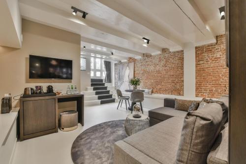 Een zitgedeelte bij Luxury Canal Suite De Heren