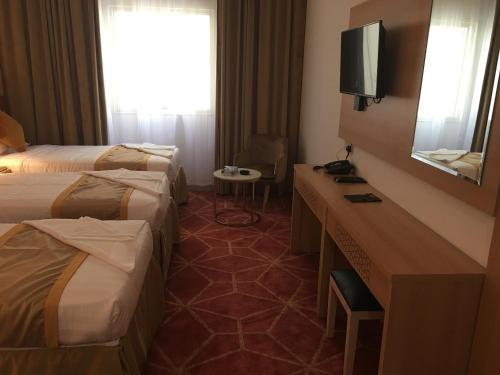 Cama ou camas em um quarto em Olayan Diamond Hotel - Al Maabda