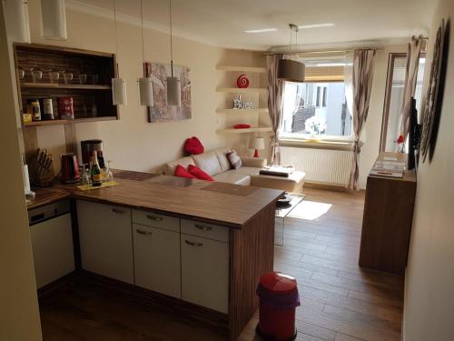 A kitchen or kitchenette at Przytulny Zakątek