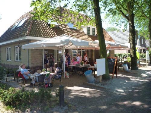 Restaurant ou autre lieu de restauration dans l'établissement Hotelsuites Ambrosijn