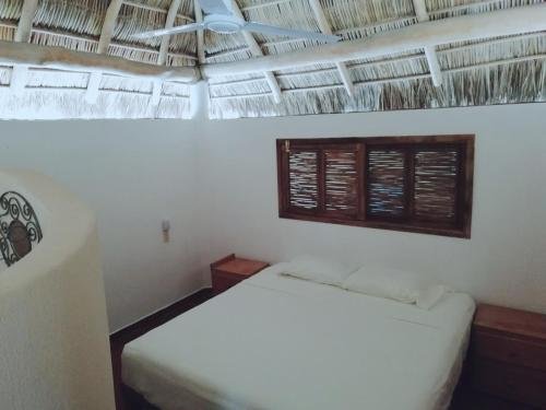A bed or beds in a room at Jardín San Pancho