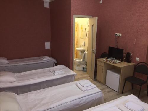 Кровать или кровати в номере Meliza Hotel