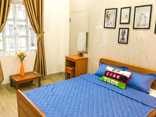 A bed or beds in a room at 202s Homestay