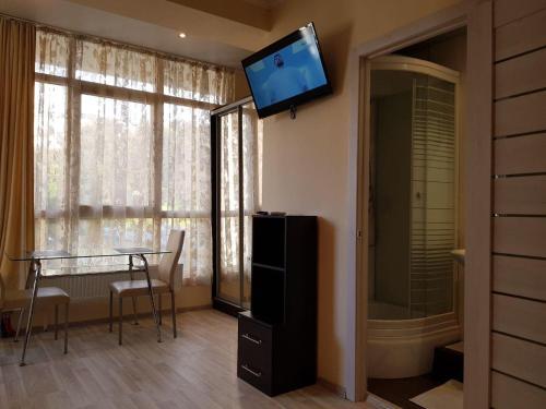 Телевизор и/или развлекательный центр в Apartment Crocus