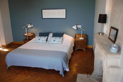 Un ou plusieurs lits dans un hébergement de l'établissement Chambres d'Hôtes Château de Martragny