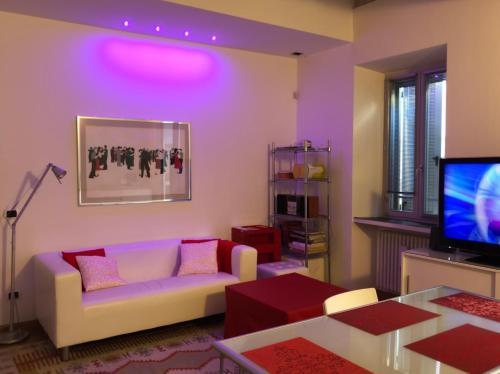 Area soggiorno di Emma home con vista Piazza Ducale