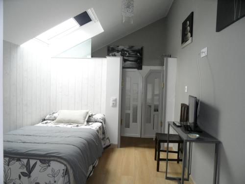 A bed or beds in a room at Casa Mañoso