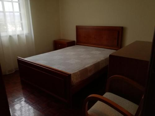 A bed or beds in a room at Casa dos Laços