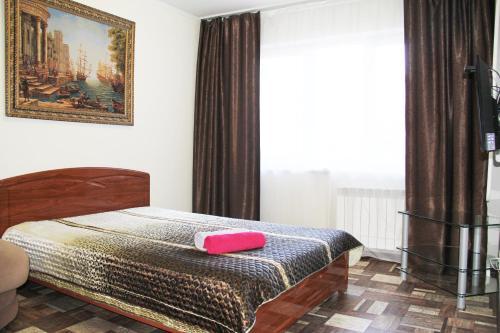 Кровать или кровати в номере Апартаменты на Проспекте Ленина