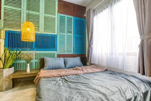A bed or beds in a room at May Home