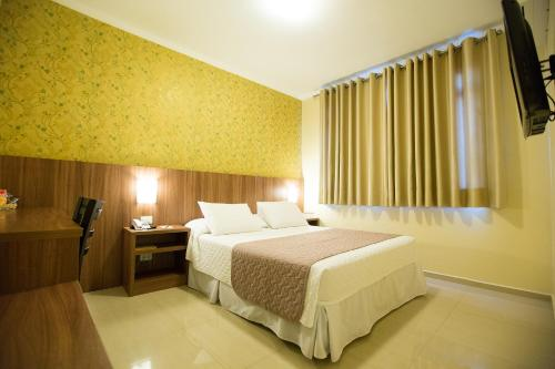 A bed or beds in a room at Pietro Angelo Hotel