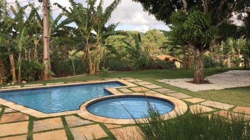 The swimming pool at or close to APARTAMENTO GUARAMIRANGA - MONTE VERDE