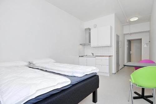 A bed or beds in a room at Anker Apartment – Grünerløkka