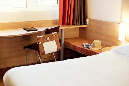 Кровать или кровати в номере ibis Novo Hamburgo