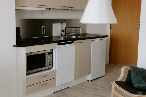 Køkken eller tekøkken på Hotel Sandvig Havn