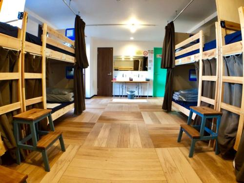 A bunk bed or bunk beds in a room at Guest House Matsu