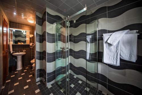 A bathroom at Hotel Magnolia