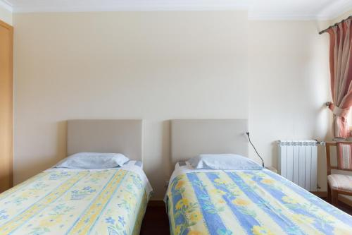 A bed or beds in a room at DeHouse