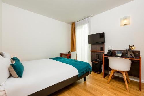 Cama o camas de una habitación en Aparthotel Adagio Access Paris Porte De Charenton