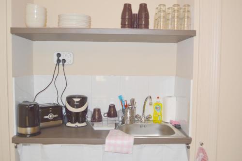 Cuisine ou kitchenette dans l'établissement Synagogue Central Guest House