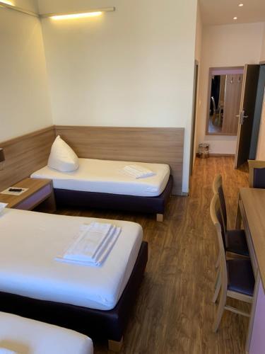 Ein Bett oder Betten in einem Zimmer der Unterkunft Slamba Hostel