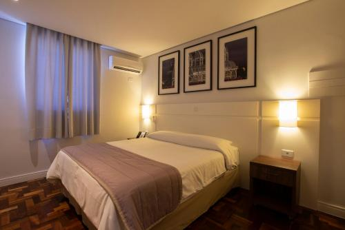 A bed or beds in a room at Hotel Centro Europeu