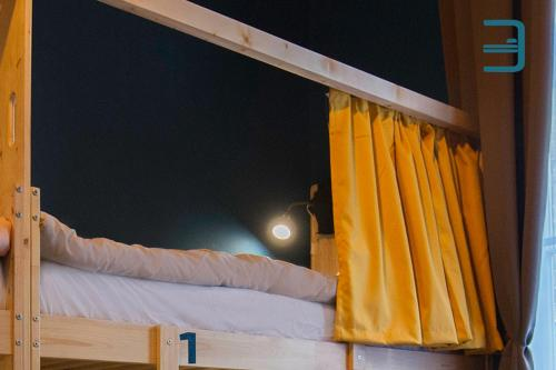 A bed or beds in a room at InVerve Hostel