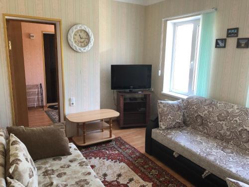 Гостиная зона в Cottage in Kislovodsk 24