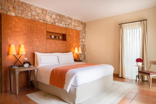 A bed or beds in a room at Terre Blanche Hotel Spa Golf Resort
