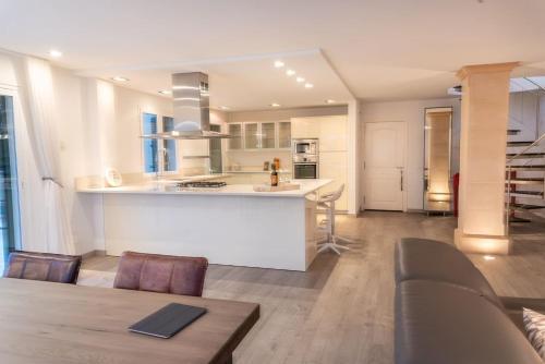 A kitchen or kitchenette at Penthouse Bella Vista