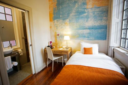 A bed or beds in a room at Matildas Hotel Boutique