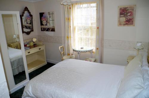 A bed or beds in a room at Croft House B&B