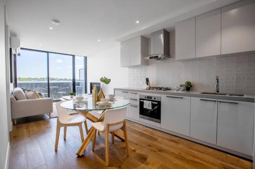 A kitchen or kitchenette at 61*Boutique one-bedroom*Boxhill Central*Mall